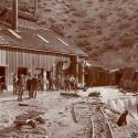 Miners watch water pour out of the Clifton Tunnel - Austin Nevada 1896